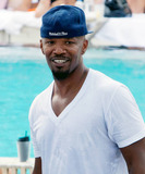 TI Tiny Photo - In town to appear at LIV nightclub at the Fontainebleau Miami Beach Academy Award winning actor and Grammy Award winning music producer Jamie Foxx relaxes poolside in South Beach after spending the early morning hours at a club with Rihanna TI Tiny Usher and Jermaine Dupri When the time finally came to head indoors Jamie who wore Versace sunglasses and carried a Gucci backpack patiently posed for pictures with some young fans Miami Beach FL  080110
