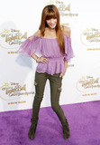 Bella Thorne Photo - Bella Thorne poses on the purple carpet after arriving for a special Picnic In The Park premiere of Tinker Bell and the Great Fairy Rescue held at La Cienega Park Los Angeles CA 082810