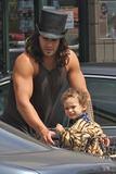Adored Photo - EXCLUSIVE Conan the Barbarian 3D star Jason Momoa wears a fun choice of a top hat for a trip to Whole Foods  The hunky actor wore a tank top showing off his muscles and arm tattoo whilst pushing his adorable son Nakoa-Wolf Manakauapo Namakaeha Momoa in a shopping cart full of groceries  Momoa is the father of two of actress Lisa Bonets children Bonets explanation of Nokoa-Wolfs name in an interview He was born on the stormest rainy night so Nakoa (warrior)Mana (strengthspirit) Kaua (rain) po (dark) The name was always going to be Nakoa-Wolf but Jason did the research on first middle name 2nd middle name as you know is Jasons  Los Angeles CA 11th August 2011Fees must be agreed prior to publication
