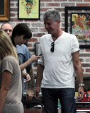 Anthony Bourdain Photo - American chef author and star of the Travel Channels Anthony Bourdain No Reservations Anthony Bourdain gets some Miami Ink during a day out in South Beach Bourdain and wife Ottavia Busia stopped in at Love Hate Tattoo Studio home of the tattoo artists starring in TLCs popular show Miami Ink where he got a snake tattoo on his forearm matching the one on Ottavias shoulder blade He proudly displayed his new tattoo as the two continued their outing strolling through the trendy Art Deco District and looked busy texting while they made a stop at a local pharmacy Bourdain is in town for the South Beach Wine and Food Festival which is taking place February 24-27 Miami Beach FL 22511