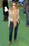 Trinny Woodall Photo - Wearing a sparkly gold jacket and oversized patterned scarf reality TV star and fashion consultant Trinny Woodall walks the green carpet at the UK premiere of Gnomeo  Juliet held at Odeon Leicester Square London UK 013011