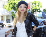Tila Tequila Nguyen Photo - Tila Tequila (Tila Nguyen) poses for photographers as she leaves Kitson on Robertson Blvd after some shopping  Tila still showed signs of an injury reportedly brought on by fans after she performed at an Insane Clown Posse concert  Fans of the Insane Clown Posse nicked named Juggalos apparently were so angry with Tequilas performance that they attacked her leaving the reality star with cuts and bruises Los Angeles CA 082410