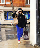 Chris Moyles Photo - BBC Radio 1 host Fearne Cotton covers up with her sweater sheltering herself from the rain after having earlier stripped down to a bikini during Chris Moyles and Comedy Daves special marathon morning show an event which crashed the radio stations website with many people wanting to catch a glimpse of the pretty blonde host in her swimwear  Cotton had agreed to strip during the 52-hour Guinness World Record breaking broadcast that was raising funds for Comic Relief if Chris and Dave got to the two million pound mark which to many peoples delight they did London UK 031811