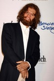 GEICO CAVEMAN Photo - Geico Caveman Arriving at the 7th Annual Dressed to Kilt Fashion Show Celebrating Homecoming Scotland 2009 at M2 Lounge in New York City on 03-30-2009 Photo by Henry Mcgee-Globe Photos Inc 2009