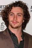 Aaron Johnson Photo - Aaron Johnson Arriving at the Premiere of the Weinstein Companys Nowhere Boy at the Tribeca Performing Arts Center in New York City on 09-21-2010 Photo by Henry Mcgee-Globe Photos Inc 2010