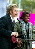 Al Roker Photo - Matt Lauer and AL Roker (Dressed As Simon and Garfunkel) at Nbcs Today Show Annual Halloween Contest in Rockefeller Plaza at the NBC Studios on October 31 2003 Photo Henry McgeeGlobe Photos Inc 2003