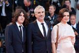 Alfonso Cuaron Photo - VENICE ITALY - SEPTEMBER 08 Tess Bu Cuaron Alfonso Cuaron and Olmo Teodoro Cuaron walk the red carpet ahead of the Award Ceremony during the 75th Venice Film Festival at Sala Grande on September 8 2018 in Venice Italy(Photo by Laurent KoffelImageCollectcom)