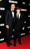 Chandler Riggs Photo - October 9 2015 New York CityActors Andrew Lincoln (L) and Chandler Riggsarriving at the season six premiere of The Walking Dead at Madison Square Garden on October 9 2015 in New York CityBy Line Philip VaughanACE PicturesACE Pictures Inctel 646 769 0430