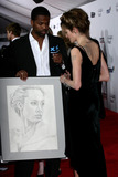 AJ Calloway Photo - Extras AJ Calloway presents actress Angelina Jolie with a handdrawned picture of herself at the New York premiere of A Mighty Heart held at Ziegfeld Theatre