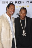 Alvin Joiner Photo - Actors DWAYNE JOHNSON aka The ROCK (left)  ALVIN JOINER aka XZIBIT at the Los Angeles premiere of his new movie Gridiron Gang at the Graumans Chinese Theatre HollywoodSeptember 5 2006  Los Angeles CA 2006 Paul Smith  Featureflash