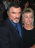 Burt Reynolds Photo - 15OCT97 Actor BURT REYNOLDS  girlfriend PAMELA SEALSat the premiere of his new movie Boogie Nights The movie is about a family of actors  filmmakers in the adult movie business