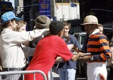 OutKast Photo - Andre Benjamin of the rap duo Outkast signs autographs before taping The Late Show With David Letterman on August 21 2006 in New York City