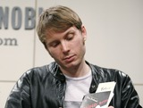Alex Kapranos Photo - Alex Kapranos poses for pictures during an appearance promoting his book Soundbites Eating On Tour With Franz Ferdinand at Barnes And Noble Union Square on January 31 2007 in New York City