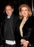 Arnaud Desplechin Photo - London UK  French film director Arnaud Desplechin and Catherine Deneuve at the  Cine Lumiere Gala Opening at the Institut Francais at 17 Queensberry South Kensington London 9th January 2008 SydLandmark Media