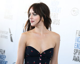 Dakota Johnson Photo - SANTA MONICA LOS ANGELES CA USA - FEBRUARY 23 Actress Dakota Johnson wearing a Gucci top pants and shoes a Sophie Buhai scrunchie and earrings and Kate Young for Tura sunglasses arrives at the 2019 Film Independent Spirit Awards held at the Santa Monica Beach on February 23 2019 in Santa Monica Los Angeles California United States (Photo by Xavier CollinImage Press Agency)