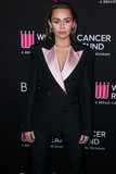 Miley Cyrus Photo - (FILE) Miley Cyrus Helps MAC Announce a 10 Million Donation for Coronavirus COVID-19 Pandemic Relief BEVERLY HILLS LOS ANGELES CALIFORNIA USA - FEBRUARY 28 Singer Miley Cyrus wearing Tom Ford arrives at The Womens Cancer Research Funds An Unforgettable Evening Benefit Gala 2019 held at the Beverly Wilshire Four Seasons Hotel on February 28 2019 in Beverly Hills Los Angeles California United States (Photo by Xavier CollinImage Press Agency)