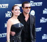 ANGELINA JOLIE Photo - (FILE) Angelina Jolie and Brad Pitt going to trial in custody case Angelina Jolie and Brad Pitt are taking their fight for custody of their children to court A trial is set to begin on December 4 2018 according to court documents obtained by CNN Jolie and Pitt separated in September 2016 after two years of marriage and filed for divorce shortly after The pair have six children together ranging from ages 10 to 17 HOLLYWOOD LOS ANGELES CA USA - MAY 28 Actors Angelina Jolie (wearing Atelier Versace) and Brad Pitt (wearing Gucci) arrive at the World Premiere of Disneys Maleficent held at the El Capitan Theatre on May 28 2014 in Hollywood Los Angeles California United States (Photo by Xavier CollinImage Press Agency)