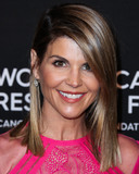 Tadashi Shoji Photo - (FILE) Lori Loughlin charged in college admissions cheating scheme Wealthy parents Hollywood actresses coaches and college prep executives were accused of carrying out a nationwide fraud to get students into prestigious universities according to a federal indictment In all 50 people including actresses Felicity Huffman and Lori Loughlin were charged in the criminal investigation that went by the name Operation Varsity Blues BEVERLY HILLS LOS ANGELES CA USA - FEBRUARY 28 Actress Lori Loughlin wearing a Tadashi Shoji dress arrives at The Womens Cancer Research Funds An Unforgettable Evening Benefit Gala 2019 held at the Beverly Wilshire Four Seasons Hotel on February 28 2019 in Beverly Hills Los Angeles California United States (Photo by Xavier CollinImage Press Agency)