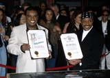 Ernie Isley Photo -  Hollywoods Rockwalk of Fame Inductions of the Isley Brothers Guitar Centerla CA 01112002 Ronald Isley and Ernie Isley Photo by Milan RybaGlobe Photosinc