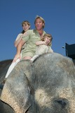 Terry Irwin Photo - The Crocodile Hunter Collision Course Premiere in Los Angeles CA Steve and Terri Irwin with Daughter Bindi Riding a Elephant Photo by Fitzroy Barrett  Globe Photos Inc 6-29-2002 K25463fb (D)
