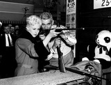 Kim Novak Photo - Kim Novak and Jeff Chandler on the Set of Jeanne Eagels at Long Beach Amusement Park in California 1957 Supplied by SmpGlobe Photos Inc Kimnovakretro