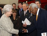 Albert Hall Photo - A14640NO UK RIGHTS UNTIL 30042004054522 03302004The Queen shakes hands with television presenter Trevor Mcdonald during a visit to the Royal Albert Hall in London marking the end of an 8 year restoration program The overhaul of one of Londons best known landmarks has cost 70 million and includes two new foyers revamped seating in the stalls and circle as well as better access for disabled patrons