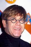 Elton John Photo - Elton John at Commemorates World Aids Day in Hard Rock Cafe New York City 11-16-1995 17129 Photo by Anthony Savignano-ipol-Globe Photos Inc