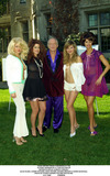 Carrie Stevens Photo - Hugh Hefner Press Confrence at the Playboy Mansion in LA For Auction of Watercolors by Alberto Vargas Kalm Olson Carrie Stevens Hugh Hefner Deanna Brooks  Karen Mcdougal Photo by Fitzroy BarrettGlobe Photos Inc 12-7-2000