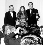 Gig Young Photo - Academy Awards  Oscars (42nd) Fred Astaire Raquel Welch and Gig Young 1970 1134 Nate CutlerGlobe Photos Inc